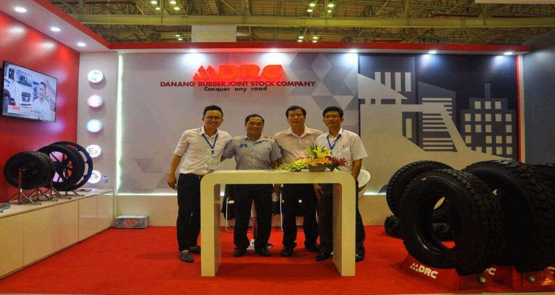 staffs of danang rubber jsc with drc tire at trade show